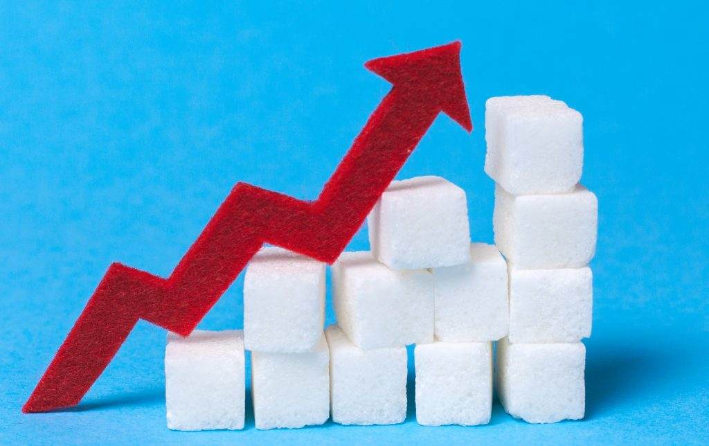 This image has an empty alt attribute; its file name is Increase-the-sugar-content-in-the-cow.-Diabetes.-Stair-of-sugar-cubes-and-a-red-arrow-up-on-a-blue-background._adragan-2-1024x644.jpeg
